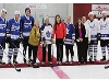 The cermonial puck drop performed by Larry Jeffrey (centre) with help from Karen Davis, to Jeffrey's left, president and CEO of Alexandra Marine and G