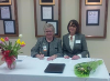CEO of AMGH Karen Davis (left) with Gateway presid