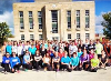 A group of participants pose for a picture in front of the Goderich Court House.