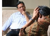 Patient with his head in his hands talking with a counsellor