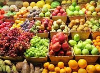 Picture of mutliple baskets of various fruit.