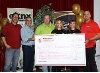 The Lucknow Kinsmen presented a cheque for $10,000 to the AMGH Foundation from its Music in the Field event.