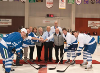 Hockey players and community members gather for the puck drop at the 1st annual hometown hockey charity game