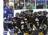 Hometown Heroes player talking to hockey kids on the ice.