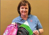 Community and Family Services Coordinator Shannon Daniels displayed some of the donated backpacks