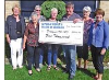 Dialysis 95+20 Committee Chairman John Grace, third from the right, receives a cheque from CWL members, from left, Ute O'Donnell, Delores VanOsch, Ros