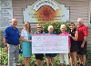 left to right: Miles Murdock, Shannon Lahay, Judy Lajuenesse, Lynn Million, Barb Lassaline, Ashley Gravett, Gary Gravett, holding a large check.