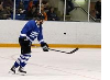 Hometown Heroes hockey player shooting the puck