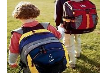 Two kids wearing back packs